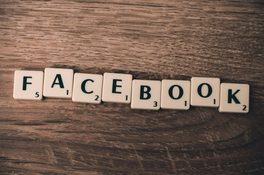 "Scrabble tiles spelling ""Facebook"", a large social media platform"