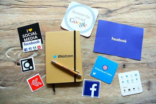 A group of social media logos on a table